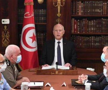 Tunisia's president fires prime minister, freezes Parliament