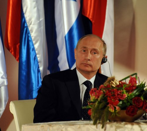 "In speech, Putin calls ""love"" basis for all actions"