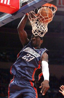 McGrady, Richardson take NBA honors