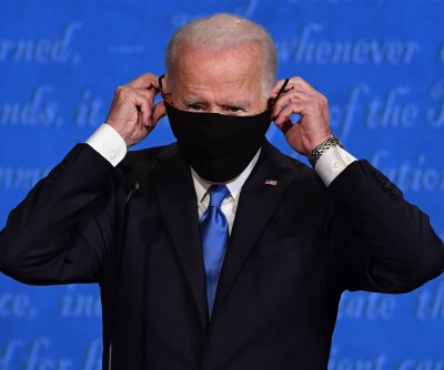 Biden promises to 'shut down the virus' in Iowa drive-in rally