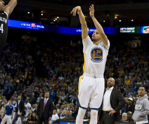 Golden State Warriors withstand Los Angeles Lakers
