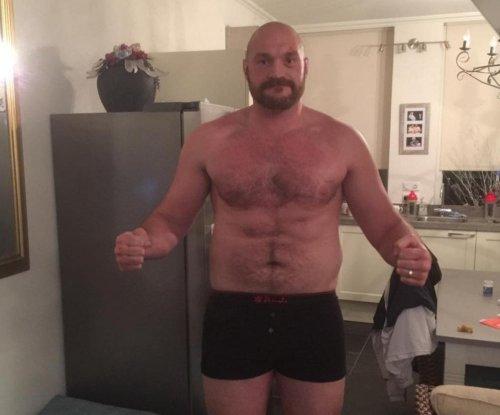 Heavyweight boxing champ Tyson Fury backs off retirement talk