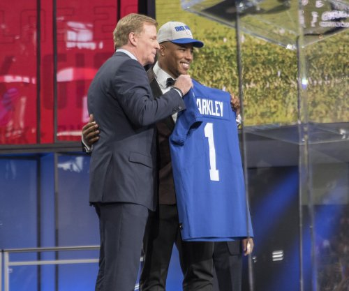 Giants' Barkley on Gettleman: 'We're there for him'