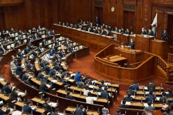 Suga tries to reassure Japan as approval rating falls