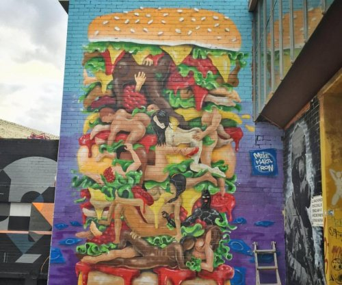 Australian artist to alter sexual cheeseburger mural