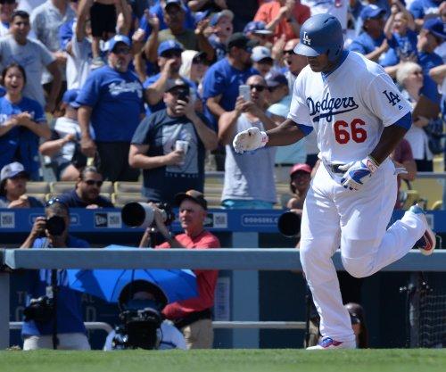 Yasiel Puig helps power Los Angeles Dodgers past San Diego Padres