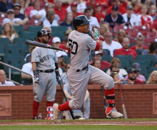 Mookie Betts' three-run double rallies Boston Red Sox past Cincinnati Reds