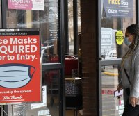 Some U.S. retailers lift mask requirements for vaccinated people
