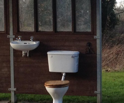 Pranksters install toilet, sink at British bus shelter