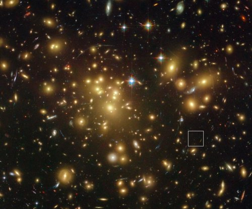 Hubble spots ancient galaxy with more dust than expected