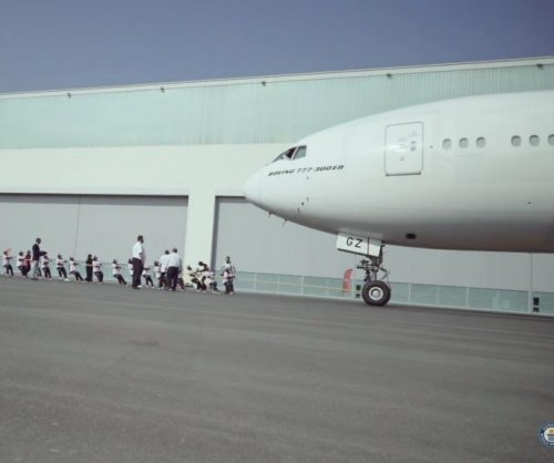 Dubai police officers pull plane to Guinness record