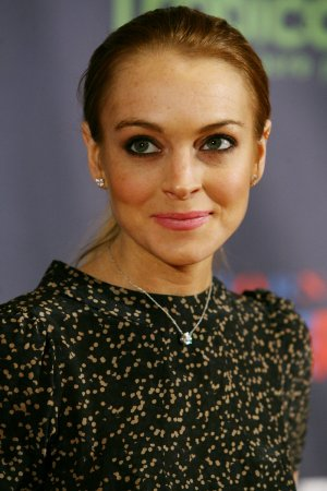 Lohan's father denies threat charges