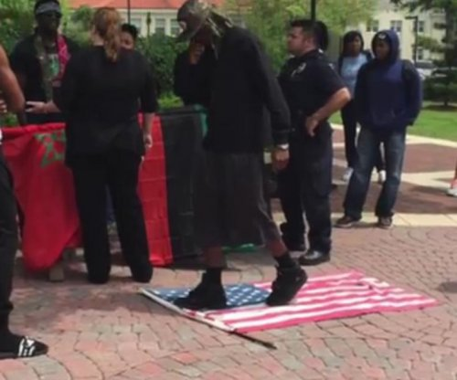 Air Force veteran detained for taking U.S. flag from protesters