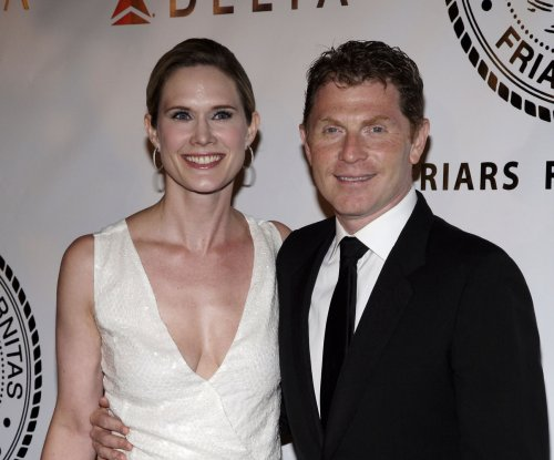 Stephanie March 'not behind' Bobby Flay 'cheater' banner