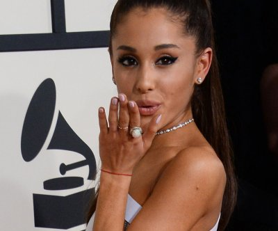 Ariana Grande, Elizabeth Gillies lock lips in new video