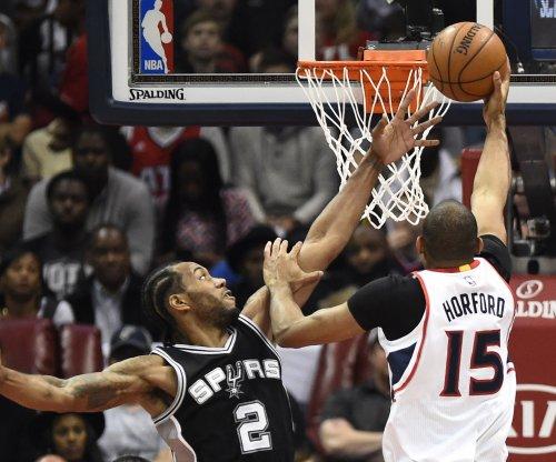 Spurs send defensive message in win
