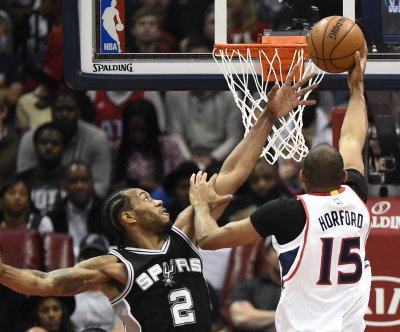 Spurs send defensive message in win