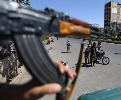 Official: Islamic State, Taliban collaborated in Afghan massacre