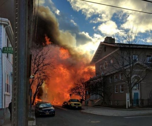 Cambridge, Mass., fire damaged 11 buildings, caused six minor injuries