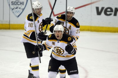 Brad Marchand's big night leads Boston Bruins past Vancouver Canucks