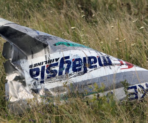 Report links Russian intelligence officer to MH17 shootdown