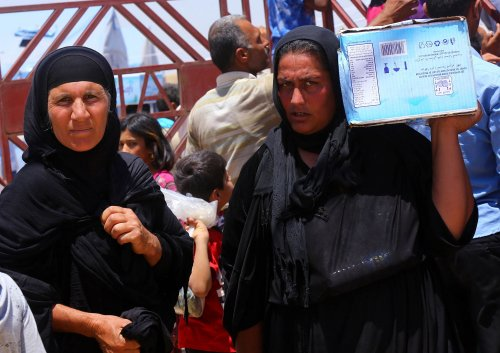 Christians in Iraq flee Islamic State advances