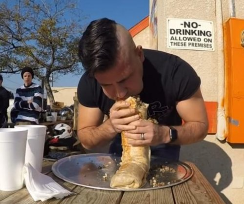 Competitive eater becomes first to finish 3-foot-long Anaconda Burrito