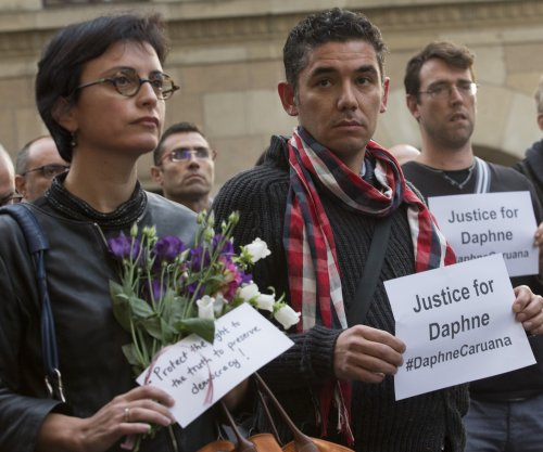 Family of slain Maltese journalist file suit against police