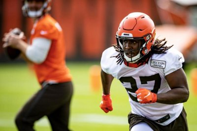 Browns GM John Dorsey, coach Freddie Kitchens attend Kareem Hunt's baptism
