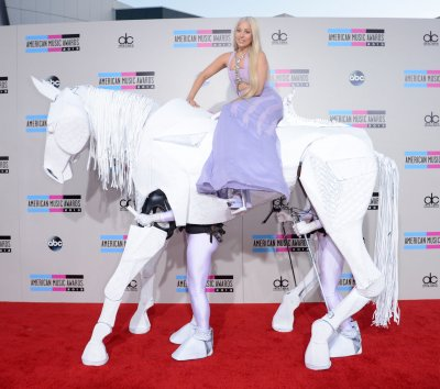 Lady Gaga rides a 'horse' to the American Music Awards