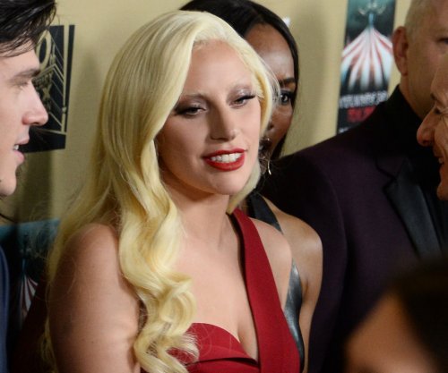 Lady Gaga honors Ryan Murphy, spends $200K in charity auction