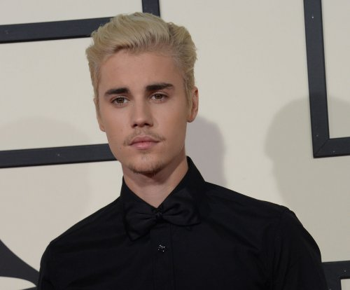Justin Bieber exposes naked rear end in camping trip photo