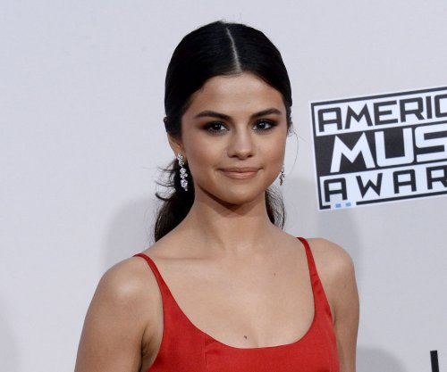 Selena Gomez surprises high school students for Coach
