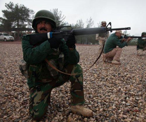 Iraqis, Kurds clash at key Syria border crossing