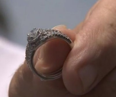 Man with metal detector finds lost diamond ring at Florida beach