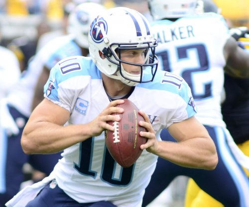 Former Tennessee Titans QB Locker says he's retiring
