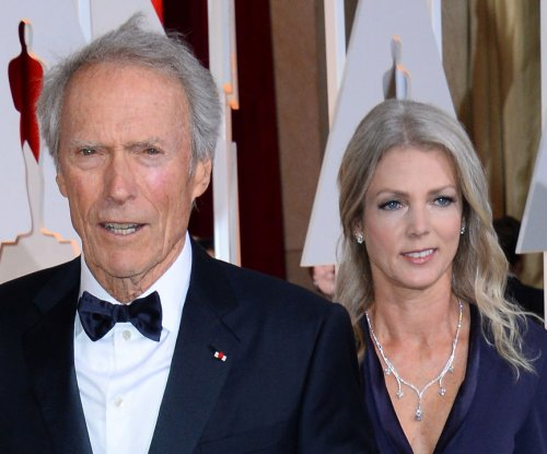 Clint Eastwood, girlfriend Christina Sandera attend 2015 Oscars