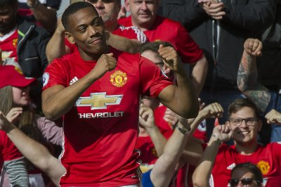 Ronald McDonald leads Manchester United, Real Madrid onto field, United's Martial destroys defense
