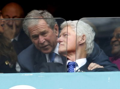 Bush, Clinton attend NCAA championship together
