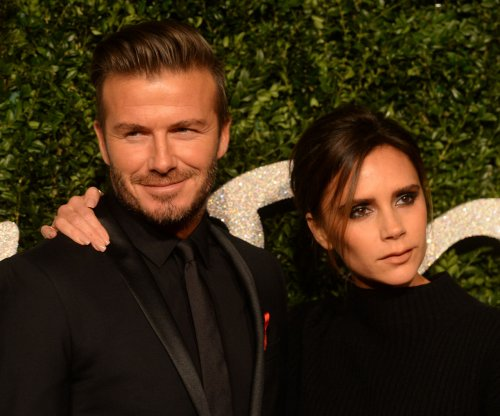 Victoria Beckham raises money by identifying tattoos on David's body
