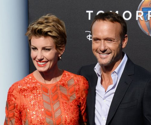 Tim McGraw, wife Faith Hill flirt at 'Tomorrowland' premiere