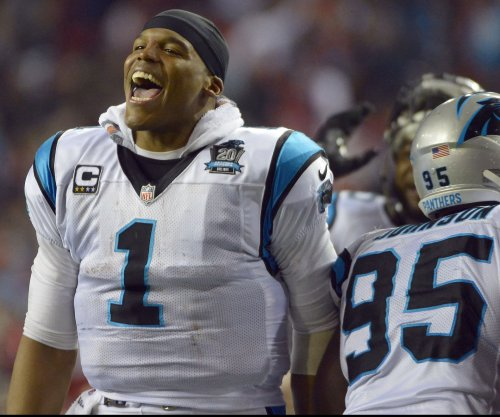 Panthers' Cam Newton gives away TD ball, despite Packers' Julius Peppers interference