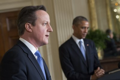White House on damage control after Obama slams Cameron for Libya