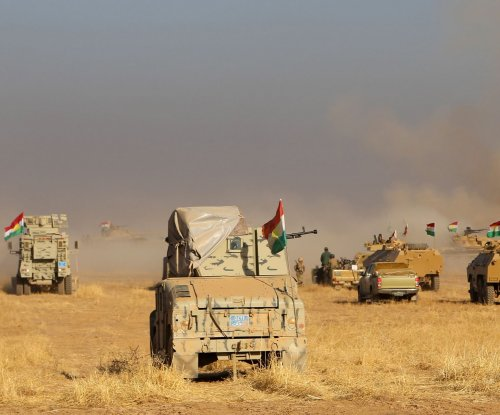 Allied forces continue sweep to Mosul; ex-governor wanted by Iraq over Turkey spat