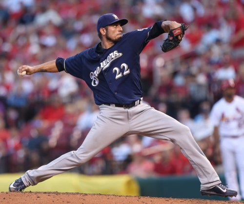 Matt Garza helps Milwaukee Brewers complete sweep