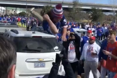 Buffalo Bills fans throw each other through flaming tables at tailgate