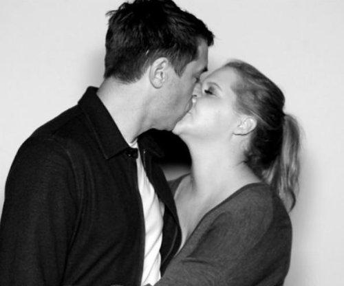 Amy Schumer kisses chef Chris Fischer in new photo