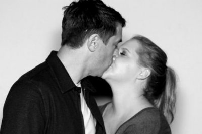 Amy Schumer kisses chef Chris Fischer in new photo
