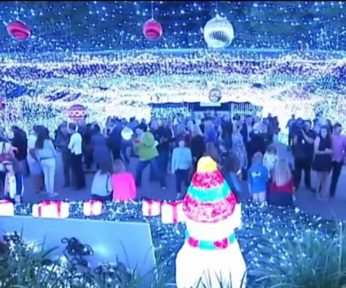 Australian lawyer breaks world record for Christmas light display