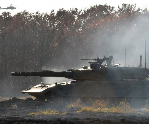 Ukraine continues battling for control of airport against rebel forces